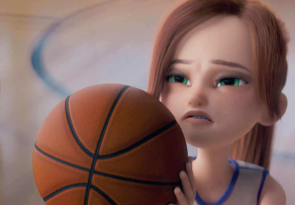 girl with basketball squinting