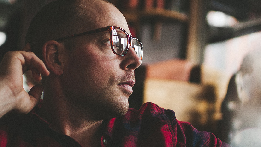 Man wearing glasses and a plaid shirt.