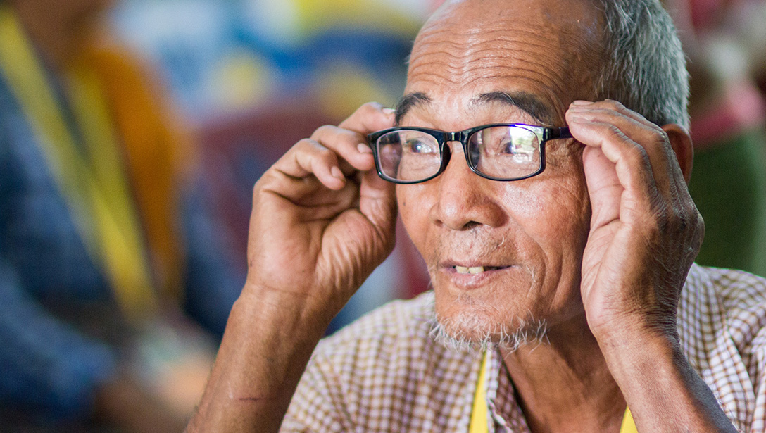 man putting on glasses